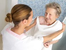 caregiver assisting her patient in shower