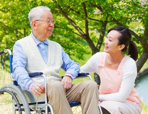 caregiver and her elderly patient